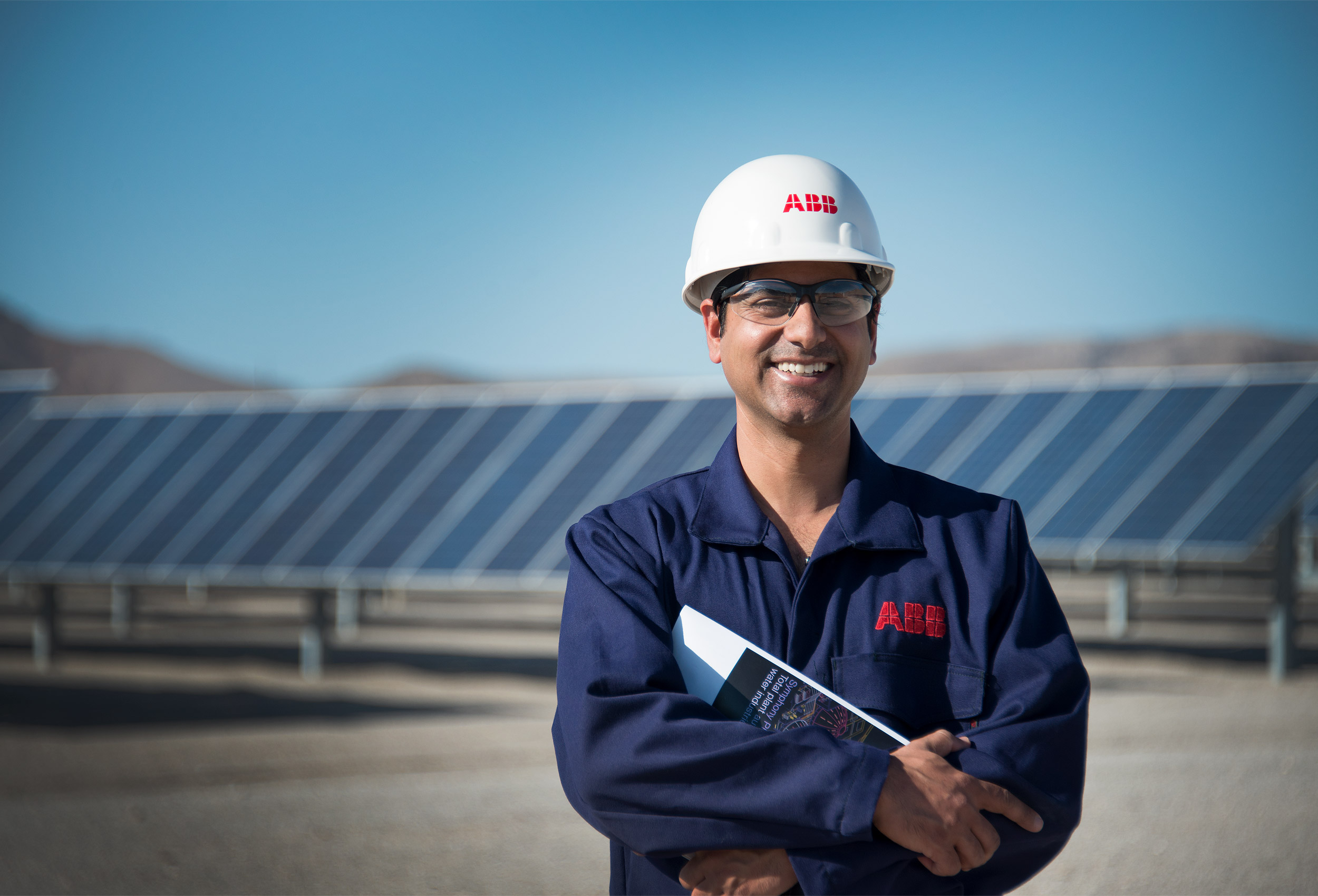 Portrait of engineer at solar farm by corporate industrial photographer Kristopher Grunert