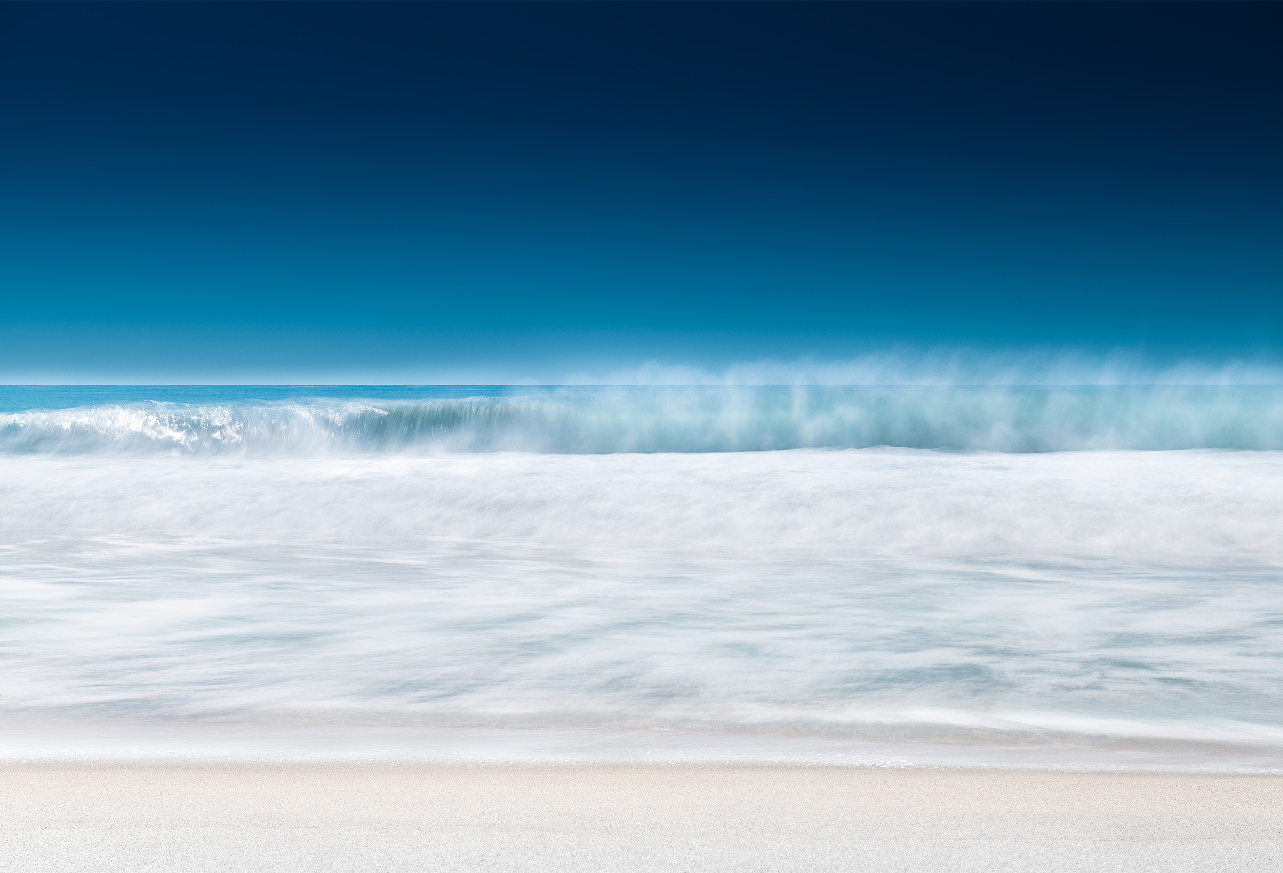 Long exposure of ocean wave at Zicatela Beach in Puerto Escondido by landscape photographer Kristopher Grunert.