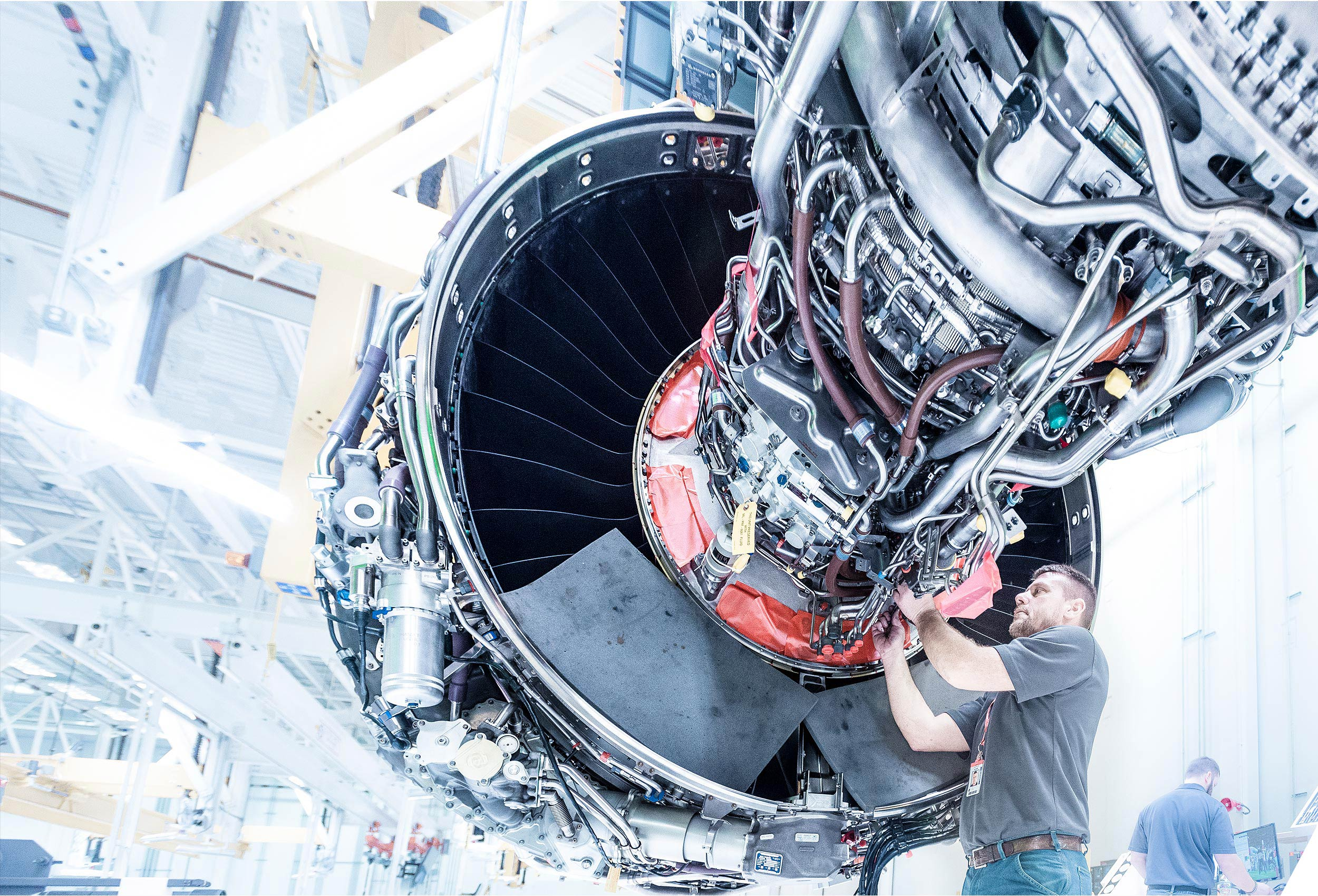 Technicians building the GE/Safran LEAP engine by corporate industrial photographer Kristopher Grunert.
